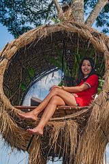 Suzan sitting in a burd nest