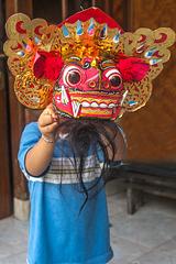 Small boy Aswin wearing Barong mask