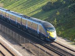 Class 395 Javelin passing Dollands Moor - 5 October 2017