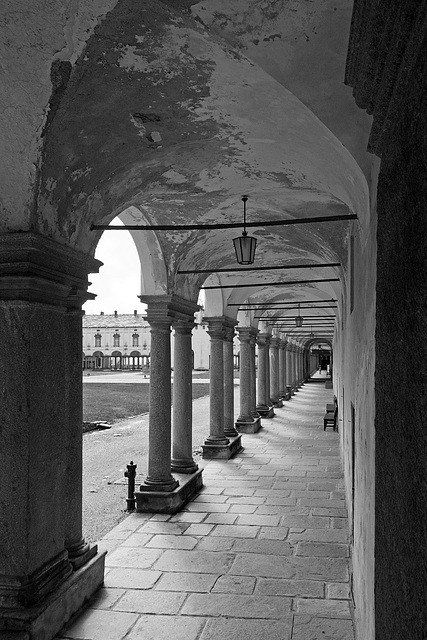 The succession of arches and columns of the cloister of Oropa, Biella