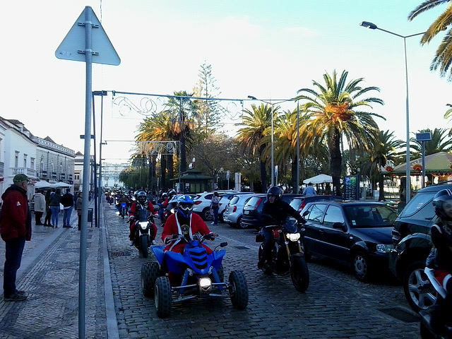 Bikers of Moto-manos Club from Luz de Tavira riding with Santa Claus clothes.