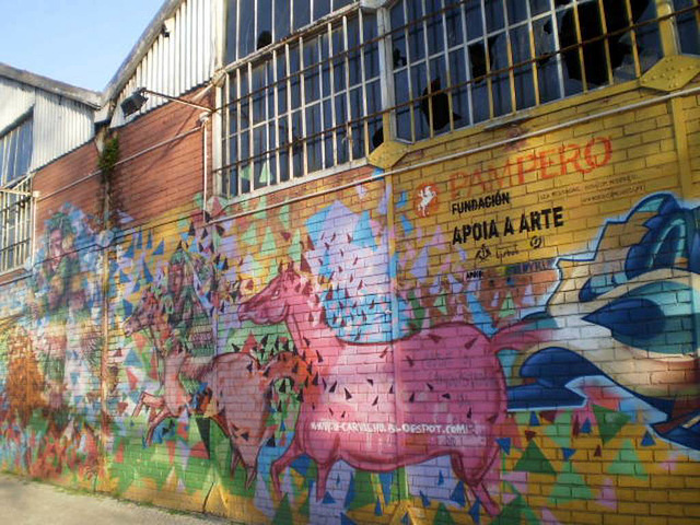 Painting on riverside warehouses.