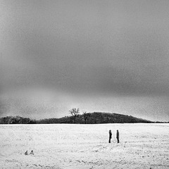 a conversation on a snowy field