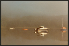 boats in the morning mist