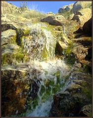 Mountain stream. Seasonal waterfall