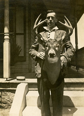 A Man and His Deer Head