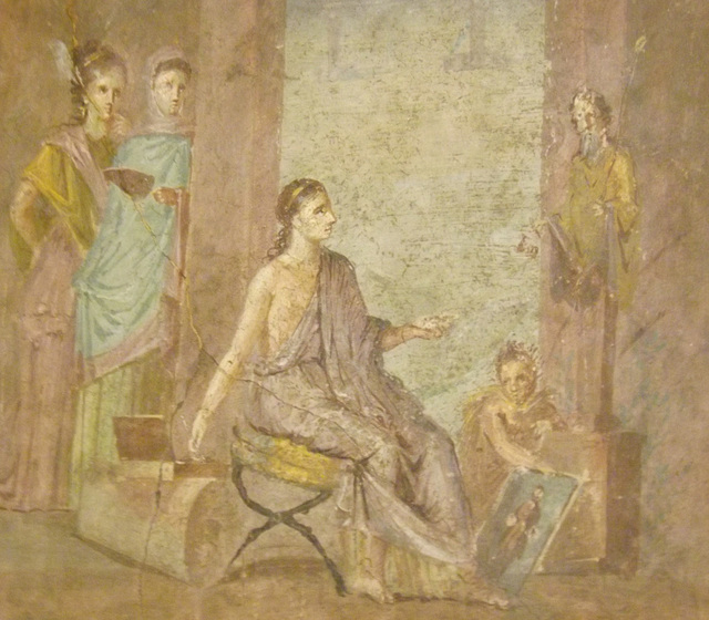 Detail of a Wall Painting with a Female Painter with a Finished Painting of Priapus from the House of the  Surgeon in Pompeii in the Naples Archaeological Museum, July 2012