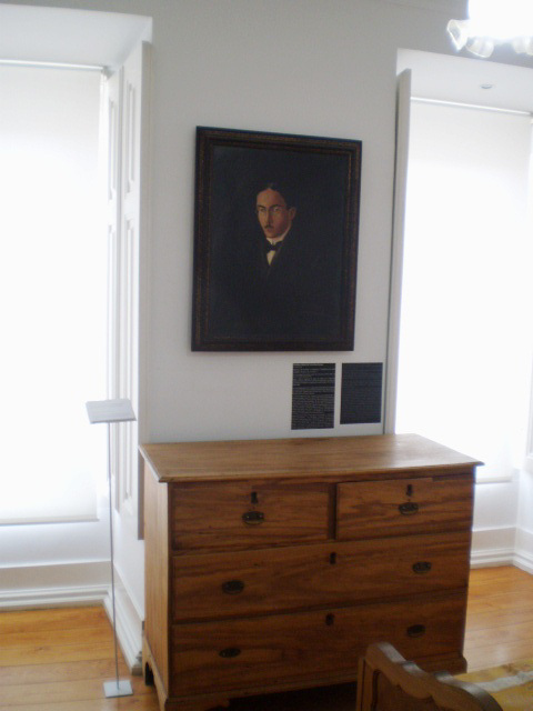 Chest of drawers and portrait of Fernando Pessoa.