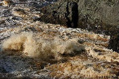 Floodwaters Pound the Rocks