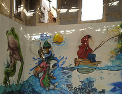 Painted on wall of former grinding plant.