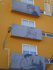 Panels attached to backside balconies.