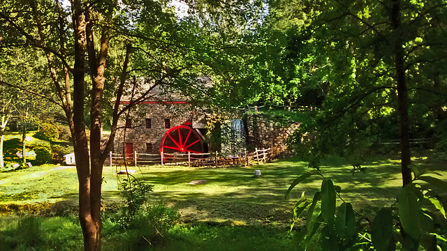 The Wayside Grist mill, with its red water wheel