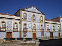 Old façade with tiles.