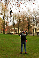 Photographing a black girl strung up from a tree.