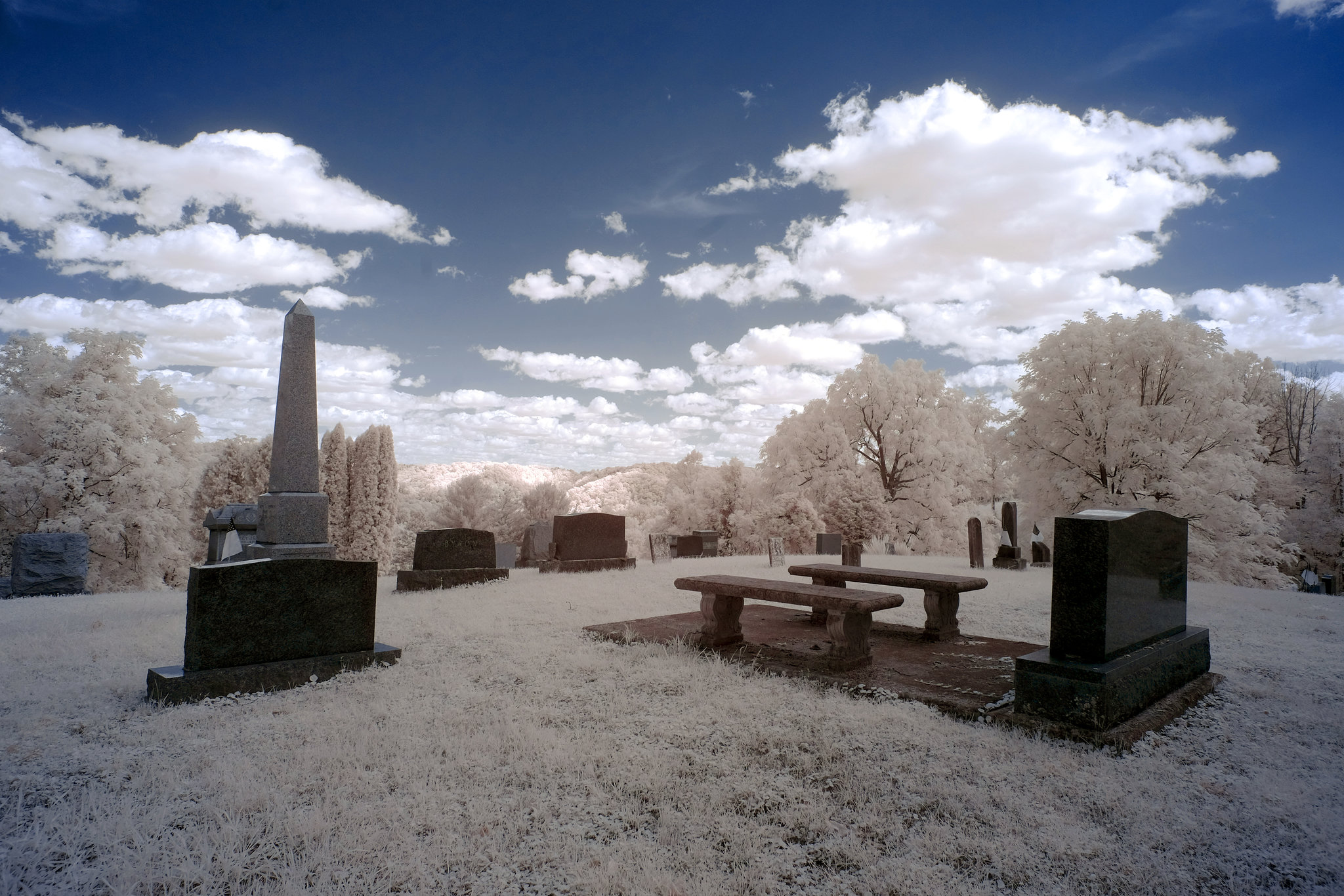 The cemetery is big but the cloud-filled sky is bigger