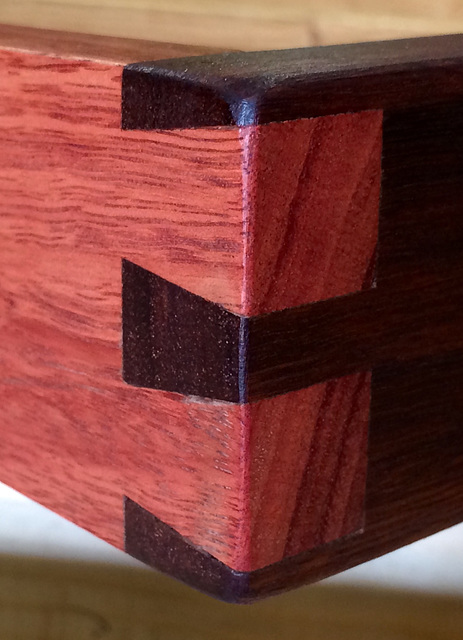 Detail of dovetail joint between light and dark Jarrah wood (swan river mahogany) frame.