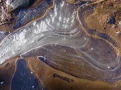 Muddy ice puddle