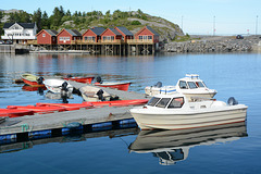 Norway, Lofoten Islands, Fishing Boats and Holiday Cabins in Reinefjorden