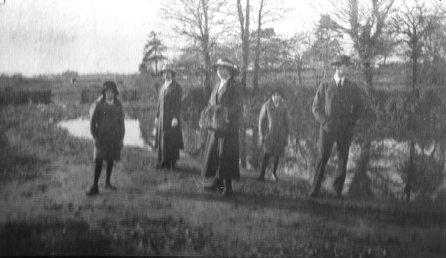 Marjory & Phyllis by the lake with older family members c1912