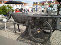 Sculpture of donkey pulled cart.