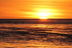 Untergehende Sonne an der Nordsee