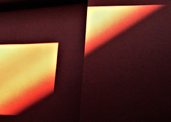 Sun and shadow, red wall abstract