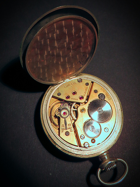 Behind the pocket watch