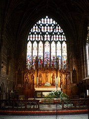 High-altar and stained glass window.