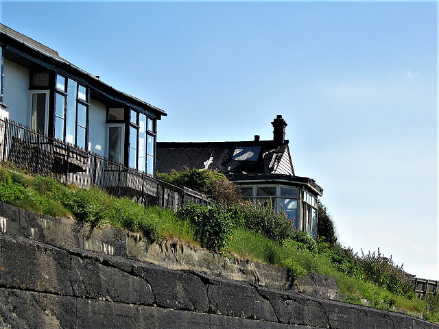This lovely little bungalow facing the beach, is falling apart