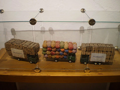 Miniatures of lorries loaded with cork.
