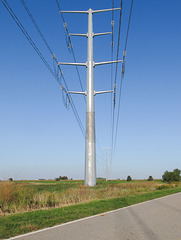 Transmission of electricity during an occurrence of autumn sunlight on the Thumb of Michigan.