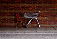 red chair and shopping trolley