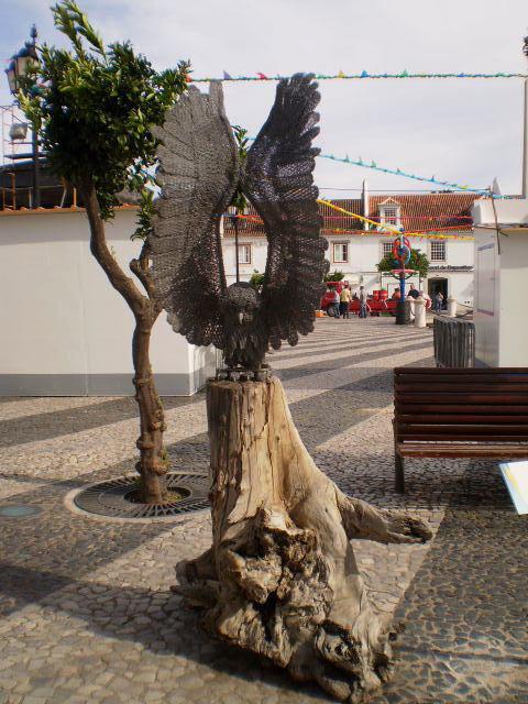 Sculpture of little owl.