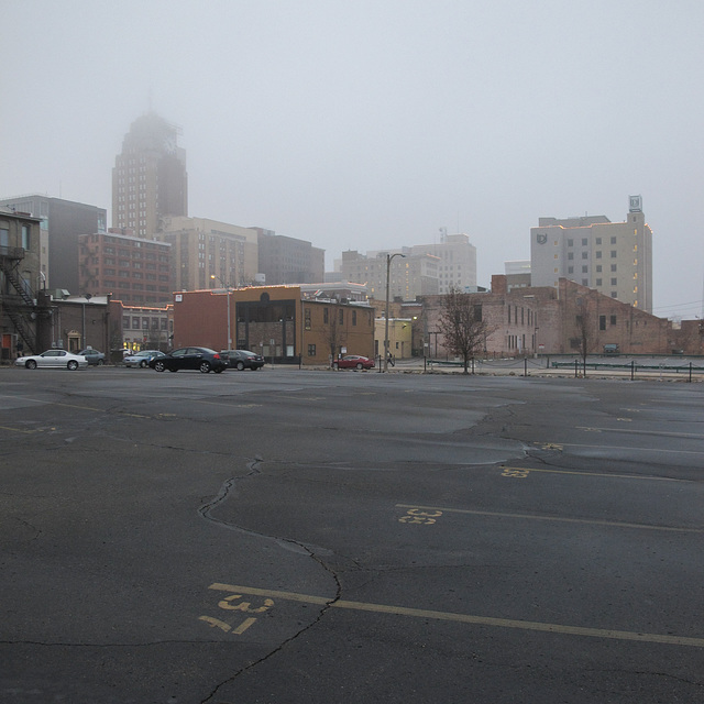A late-afternoon winter fog afflicts downtown Lansing in mid-December.