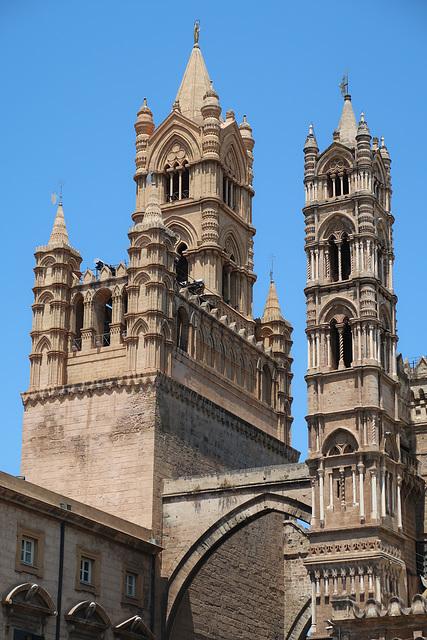 Arch over Via Matteo Bonello, and some ornate towers