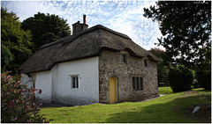 White & Stone Thatched Cottage