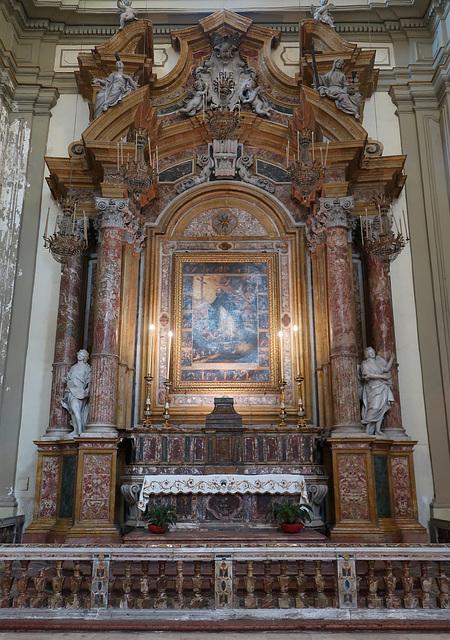 Ornate marble side altar