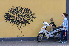 boy scooter and mural