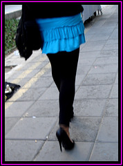 Black pumps and tights with short skirt