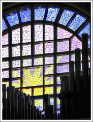 Stained glass window behind the pipe organ