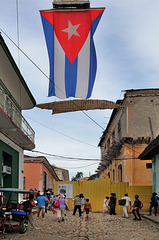 Cuba national flag over an alley in Trinidad