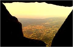 La Cabrera town from a rock window along the ridge