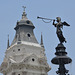 Lima, The Main Square, Bronze Figurine on the Top of the Fountain and the Top of the Bell Tower of the Cathedral
