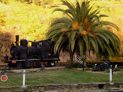 Ancient locomotive and railway quad.