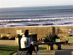 A couple enjoying the sun and the sea