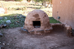 An outdoor oven which are popular in Pueblos