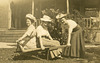 Three Women with Hats and a Wheelbarrow