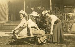 Three Women with Hats and a Wheelbarrow