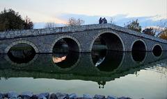 On the stone bridge at the sunset