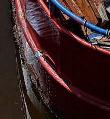 A Boat. Light, Ripples, Rust And Rot
